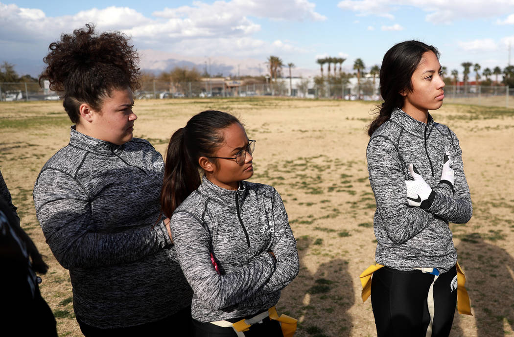 Tiarra Del Rosario, one of the best flag football players in the state, Tesha Houpe, left, and Catherine Javan, center, attend practice at Cimarron-Memorial High School in Las Vegas on Monday, Feb ...