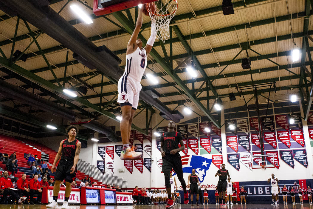 Liberty's Julian Strawther (0) dunks while playing against Las Vegas at Liberty High School in Henderson on Tuesday, Feb. 13, 2018. Liberty won 82-70.  Patrick Connolly Las Vegas Review-Journal @P ...
