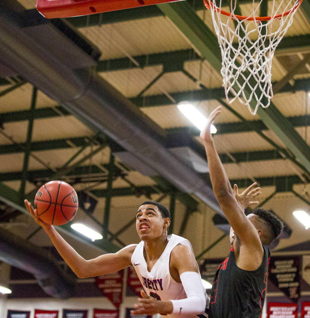 Liberty's Julian Strawther (0) goes up for a shot while Las Vegas' Zach Matlock (24) tries to block him at Liberty High School in Henderson on Tuesday, Feb. 13, 2018. Liberty won 82-70.  Patrick C ...