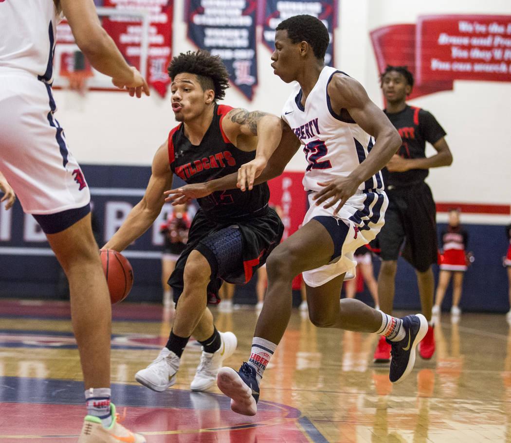 Las Vegas' Donovan Joyner (12) attempts to dribble around Liberty's Jordan Wafer (22) at Liberty High School in Henderson on Tuesday, Feb. 13, 2018. Liberty won 82-70.  Patrick Connolly Las Vegas  ...