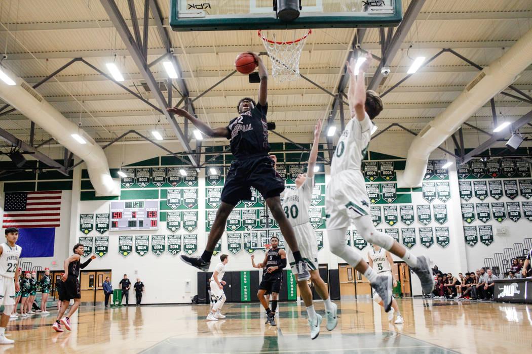 Cimarron-Memorial's Brian Washington (32) gets a rebound during the fourth quarter of a basketball game against Palo Verde at Palo Verde High School in Las Vegas, Thursday, Dec. 7, 2017. Ci ...