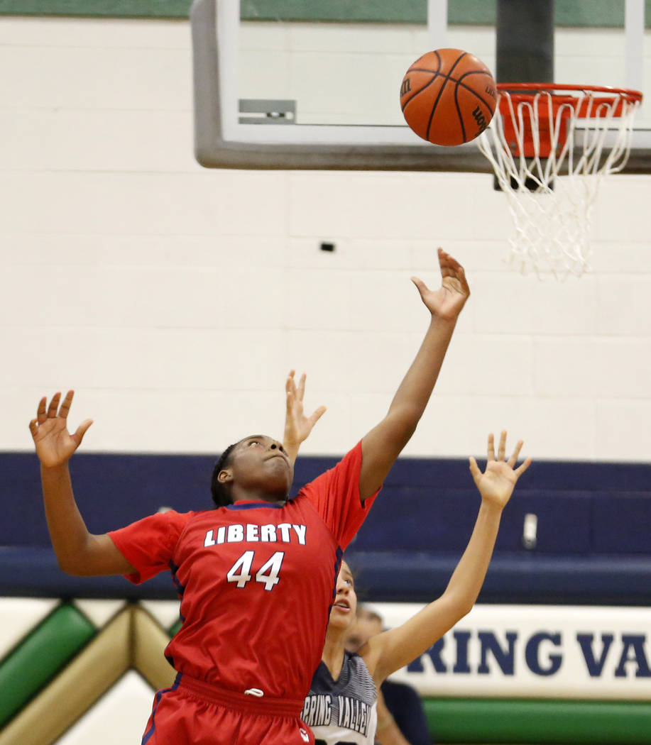 Liberty High's Dre'una Edwards (44) shoots against Spring Valley during a girl's basketball game at Spring Valley High School in Las Vegas, Monday, Jan. 29, 2018. Andrea Cornejo/Las Vegas Review-J ...