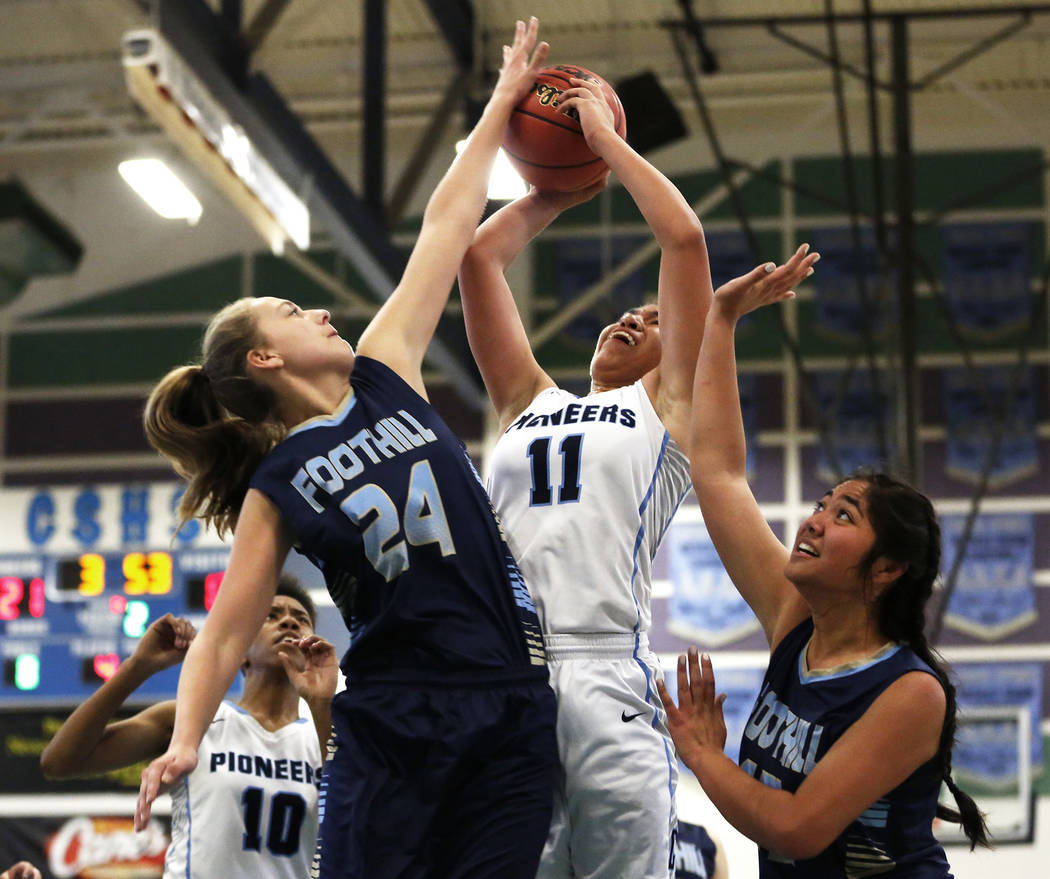 Canyon Springs' Jeanette Fine (11) tries to shoot against Foothill's Laurel Rockwood (24) and Keilani Brown right, during the Sunrise Region semifinals at Canyon Springs High School in North Las V ...