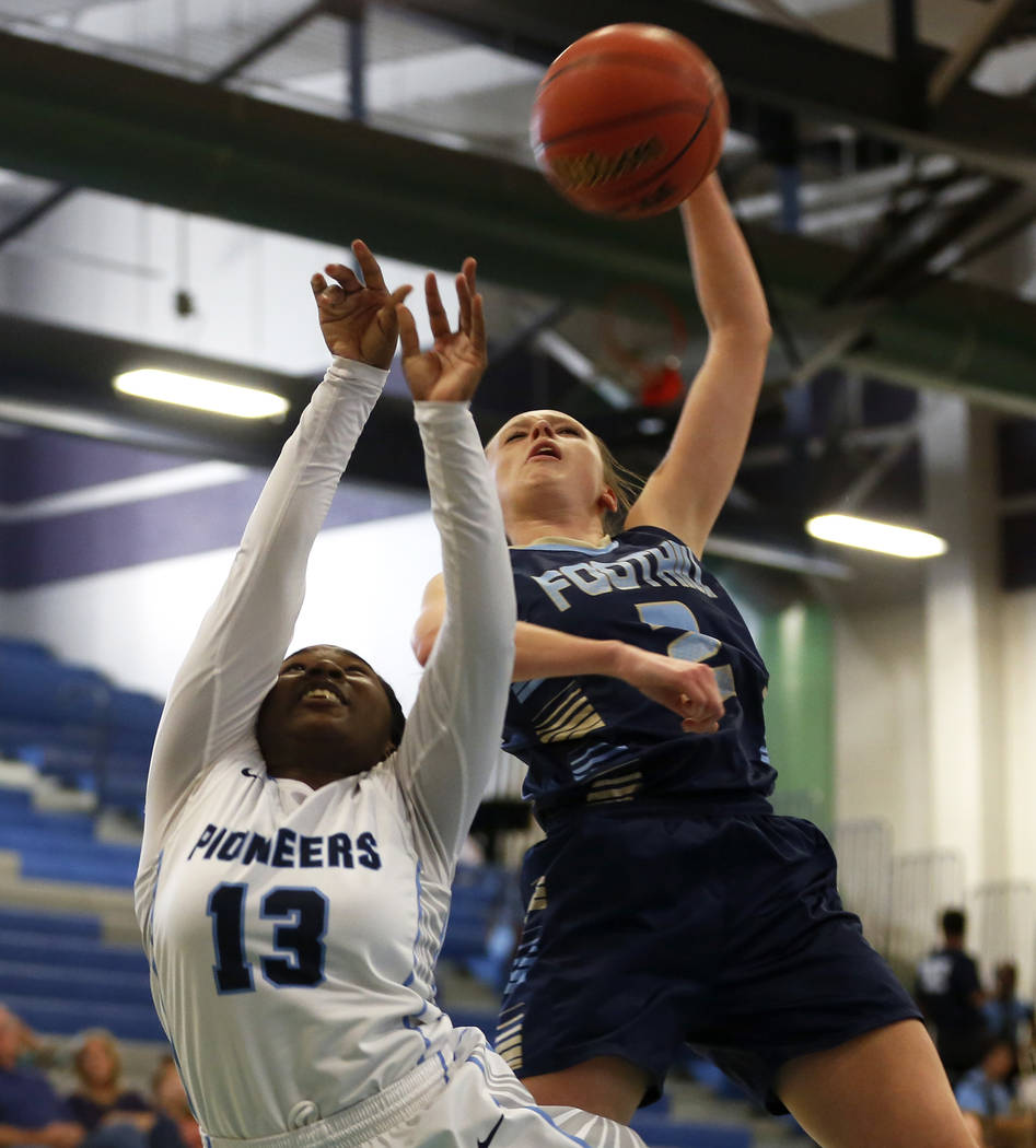 Canyon Springs' Ke'Ajanae Haley (13) defends against Foothill's Aqui Williams (2) during the Sunrise Region semifinals at Canyon Springs High School in North Las Vegas on Thursday, Feb. 15 2018. A ...