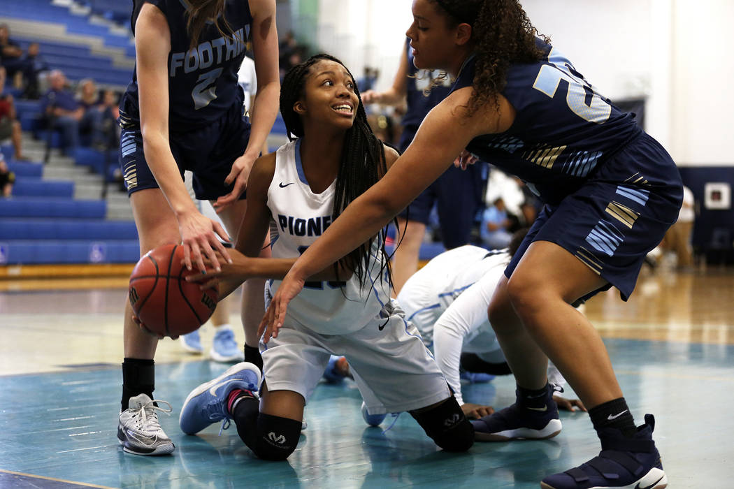 Canyon Springs' Iyani Hayden (23) fights for the ball against Foothill during the Sunrise Region semifinals at Canyon Springs High School in North Las Vegas on Thursday, Feb. 15 2018. Andrea Corne ...
