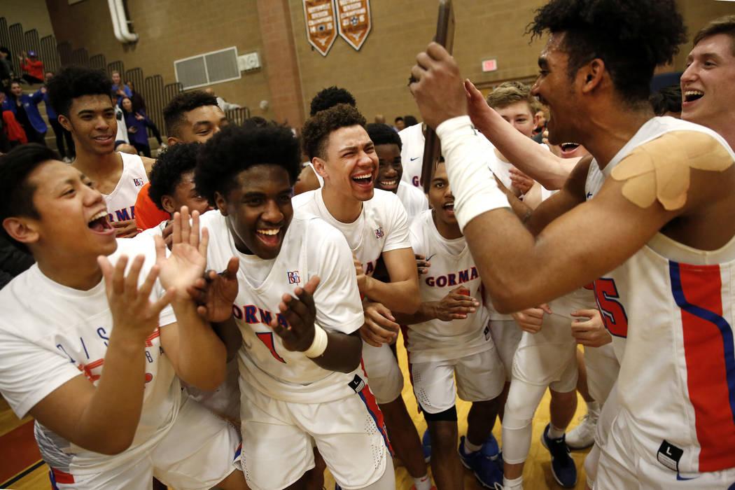 Bishop Gorman boys basketball team celebrates after beating Clark in the Sunset Region boys basketball championship at Legacy High School in North Las Vegas on Saturday, Feb. 17, 2018. Bishop Gorm ...