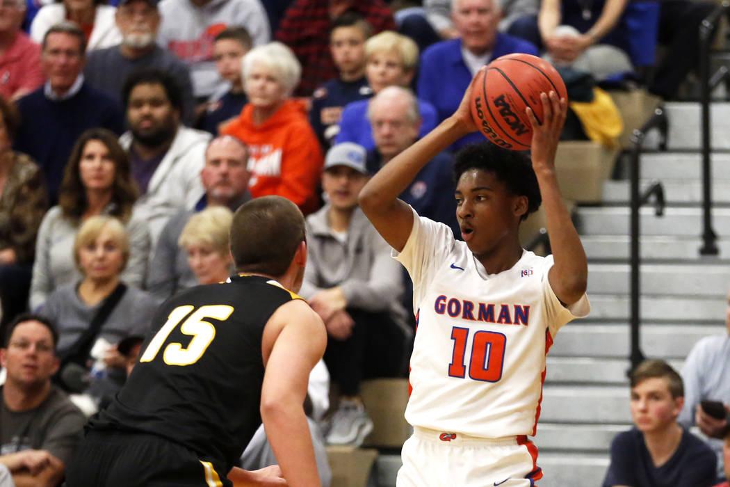 Bishop Gorman's Zaon Collins (10) shoots against Clark's James Bridges (15) during the Sunset Region boys basketball championship at Legacy High School in North Las Vegas on Saturday, Feb. 17, 201 ...