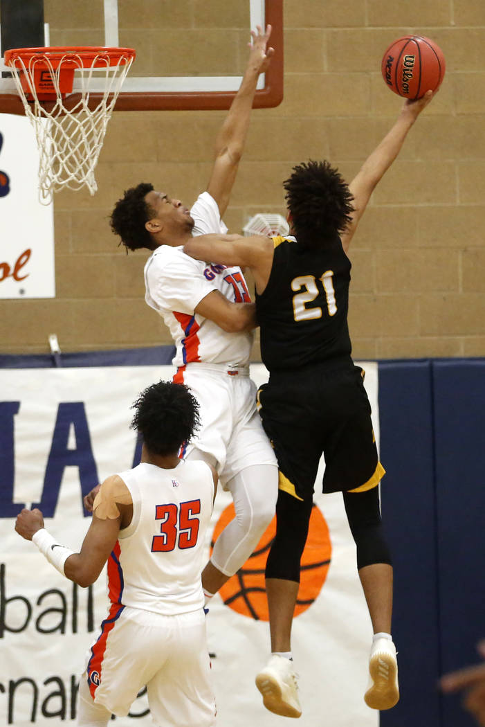 Bishop Gorman's Jamal Bey (35) defends against Clark's Jalen Hill (21) during the Sunset Region boys basketball championship at Legacy High School in North Las Vegas on Saturday, Feb. 17, 2018. Bi ...