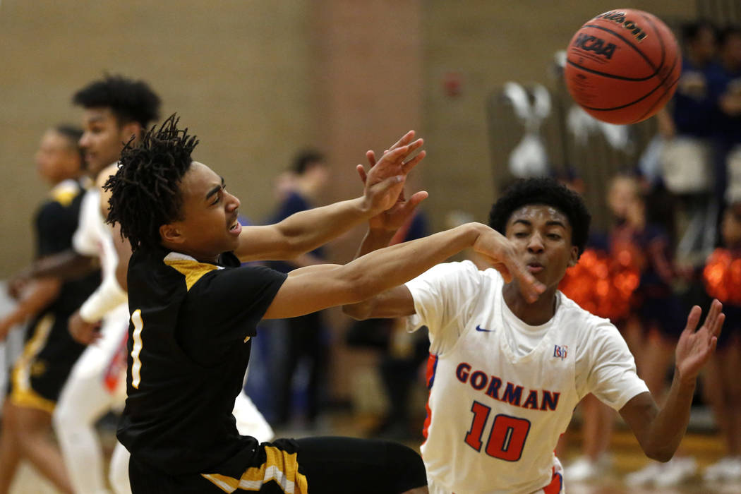 Clark's Frankie Collins (1) defends against Bishop Gorman's  Zaon Collins (10) during the Sunset Region boys basketball championship at Legacy High School in North Las Vegas on Saturday, Feb. 17,  ...