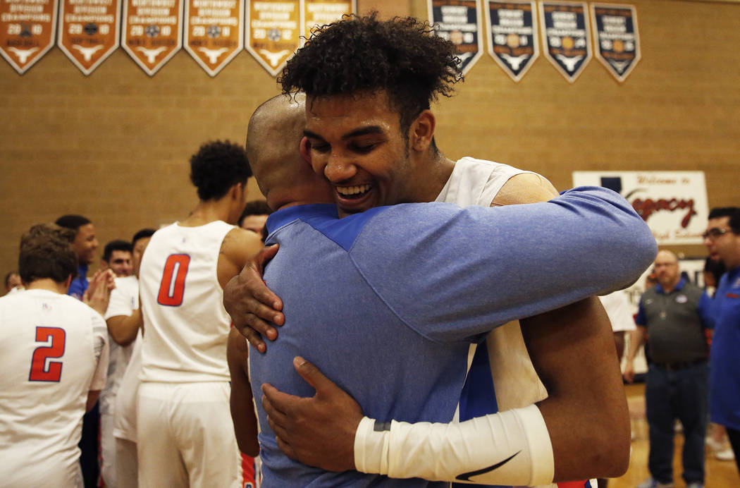 Bishop Gorman's Jamal Bey (35) celebrates after helping beat Clark during the Sunset Region boys basketball championship at Legacy High School in North Las Vegas on Saturday, Feb. 17, 2018. Bishop ...