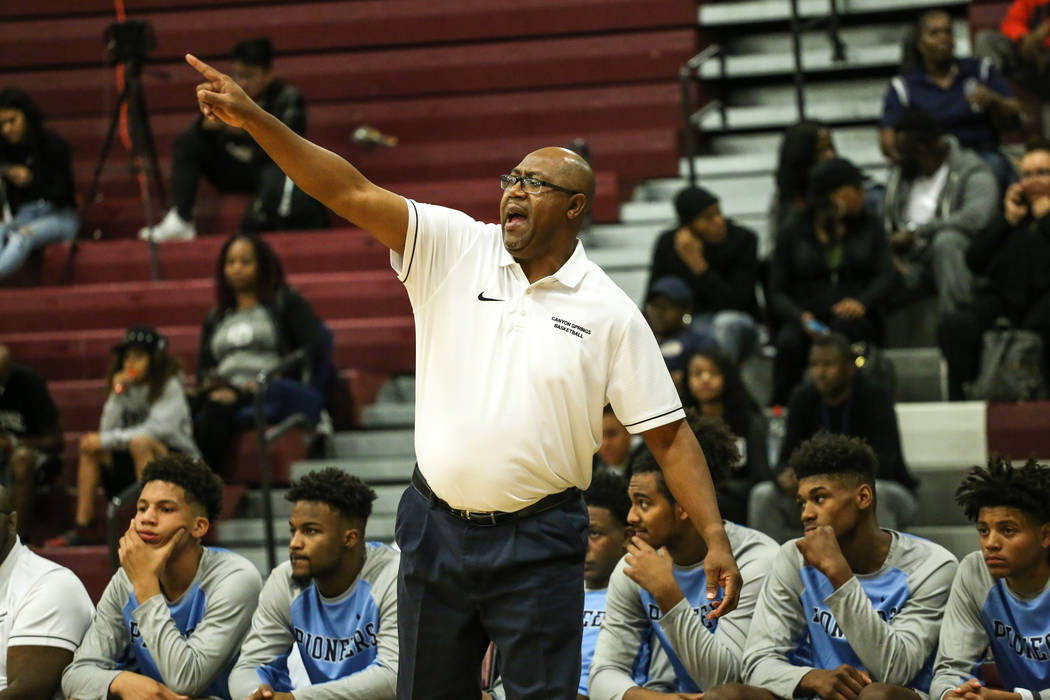 Canyon Springs head coach Freddie Banks reacts during the third quarter of basketball game against Desert Oasis at Desert Oasis High School in Las Vegas, Monday, Nov. 27, 2017. Canyon Springs won  ...
