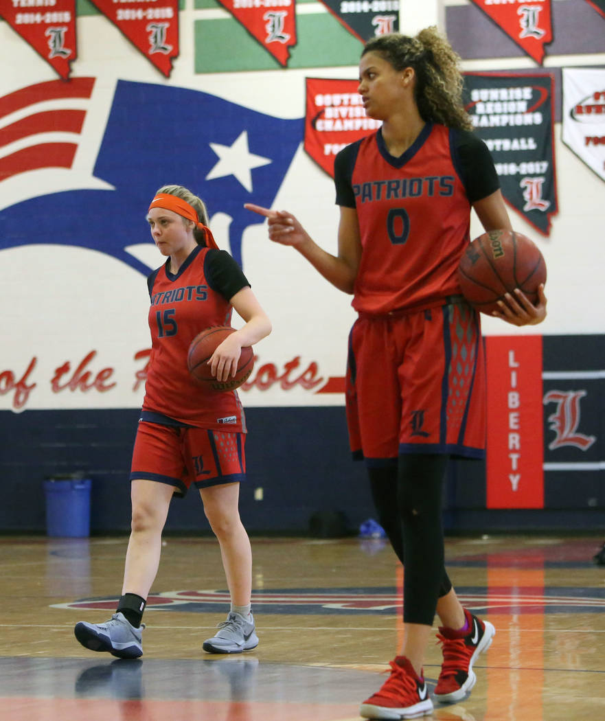 Liberty High's basketball players London Pavlica (15) and Rae Burrell (0) during their last day of practice at their school on Tuesday, Feb. 20, 2018, in Las Vegas. Bizuayehu Tesfaye/Las Vegas Rev ...