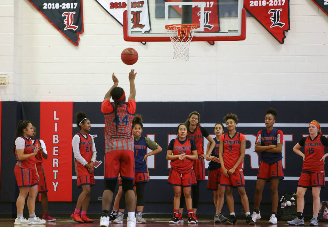 Liberty High's basketball players watch as Dre'una Edwards (44) shoots a free throw during their last day of practice at their school on Tuesday, Feb. 20, 2018, in Las Vegas. Bizuayehu Tesfaye/Las ...