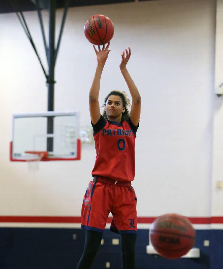 Liberty High's Rae Burrell shoots for the basket during teams practice at their school on Tuesday, Feb. 20, 2018, in Las Vegas. Bizuayehu Tesfaye/Las Vegas Review-Journal @bizutesfaye