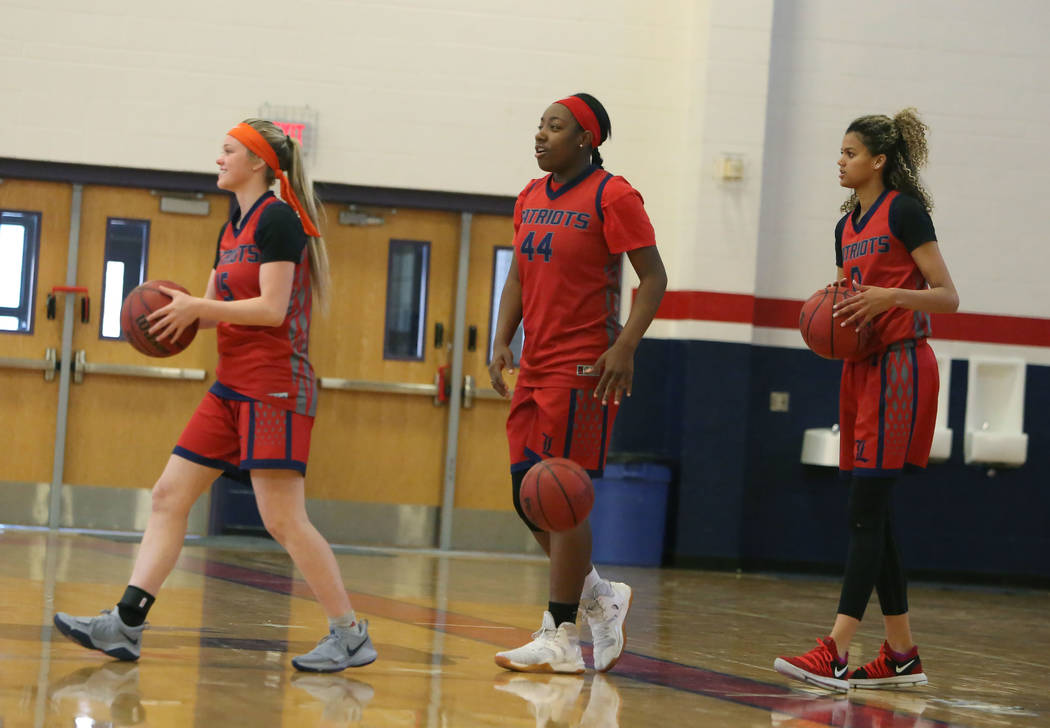 Liberty High's basketball players London Pavlica (15), left, Dre'una Edwards (44), center, and Rae Burrell during their last day of practice at their school on Tuesday, Feb. 20, 2018, in Las Vegas ...