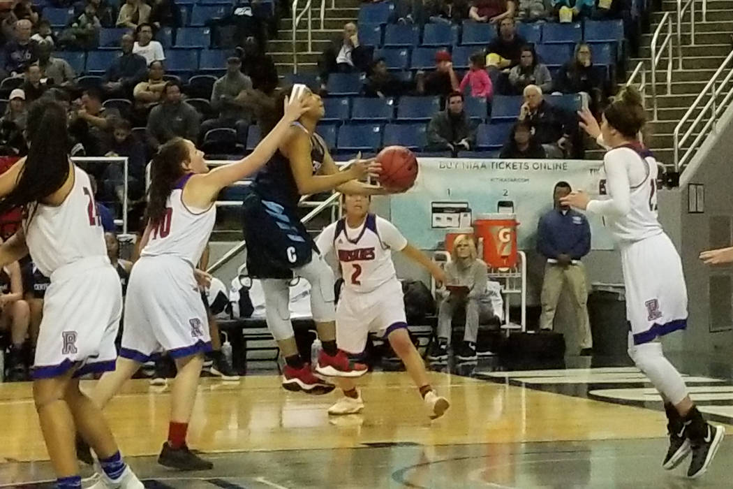 Centennial's Ajanhai Phoumiphat drives to the basket against Reno on Thursday, Feb. 22, 2018 at Lawlor Events Center in Reno. Centennial beat Reno High 68-30 in the Class 4A state semifinals. (Dam ...