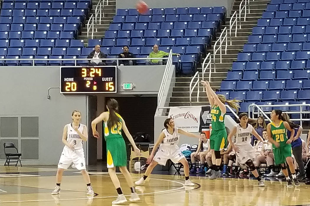 Eureka's Cody Gibbs fires a 3-pointer over Pahranagat Valley's Karley Whipple on Friday, Feb. 23, 2018 at Lawlor Events Center in Reno. (Damon Seiters/Las Vegas Review-Journal)