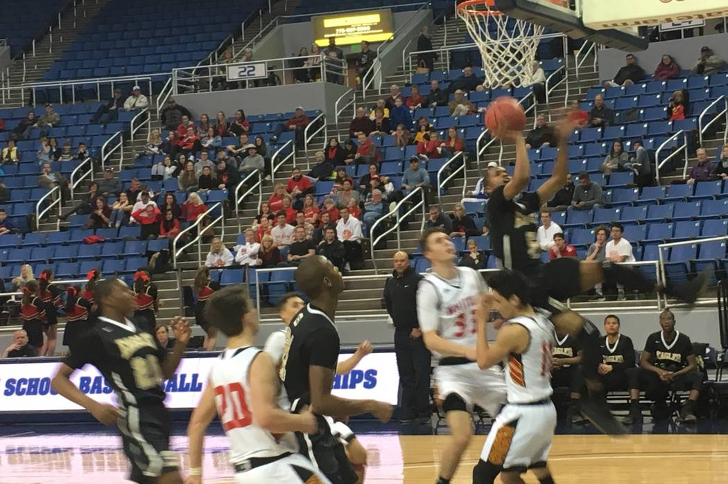 Spring Mountain's Shawn Shumpert goes up for a shot during the team's Class 1A state semifinal game against Whittell at the Lawlor Events Center in Reno, Feb. 23, 2018. Justin Emerson/Las Vegas Re ...
