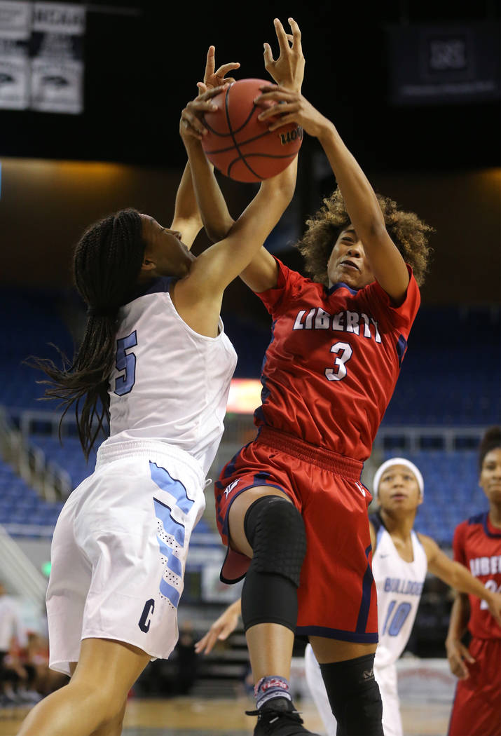 Centennial's Jade Thomas fights for the ball with Liberty's Journie Augmon during the NIAA state basketball tournament in Reno, Nev., on Friday, Feb. 23, 2018. Centennial won the title, 74-65 in o ...