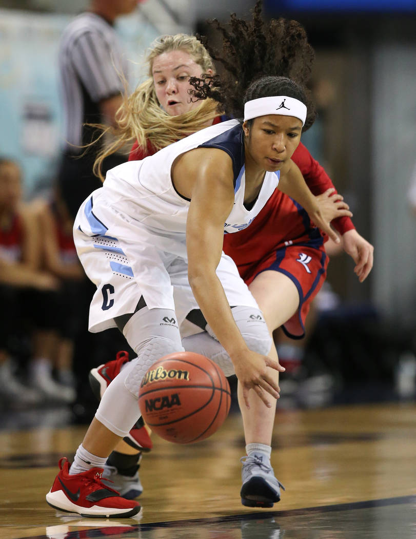 Liberty's London Pavlica and Centennial's Ajanhjai Phoumiphat fight for a loose ball during the NIAA state basketball tournament in Reno, Nev., on Friday, Feb. 23, 2018. Centennial won 74-65 in ov ...