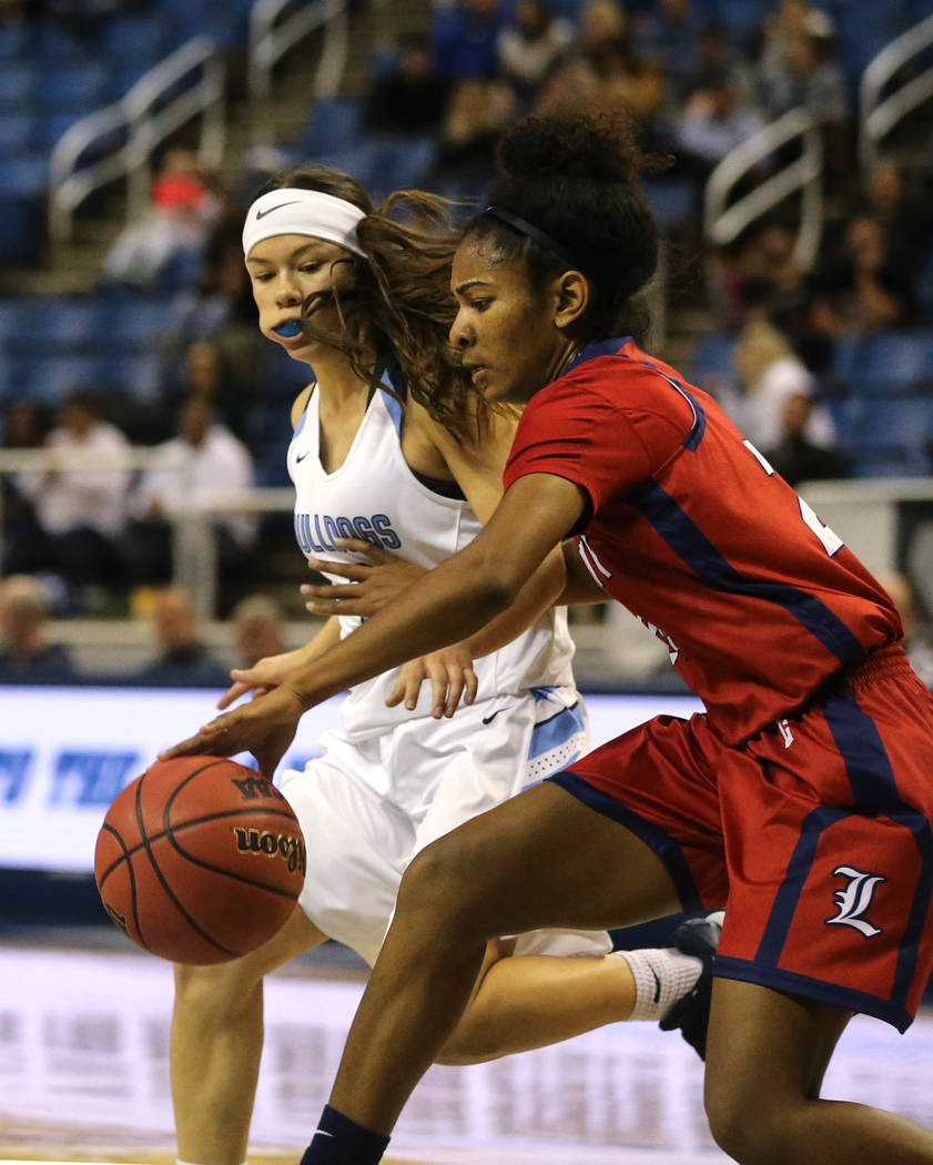 Liberty's Trinity Vasquez dribbles around Centennial defender Melanie Isbell during the NIAA state basketball tournament in Reno, Nev., on Friday, Feb. 23, 2018. Centennial won the title, 74-65 in ...