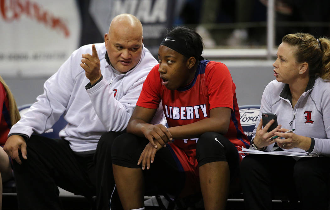 Liberty's Dre'una Edwards talks with assistant coaches during the NIAA state basketball tournament in Reno, Nev., on Friday, Feb. 23, 2018. Centennial won 74-65 in overtime. Cathleen ...
