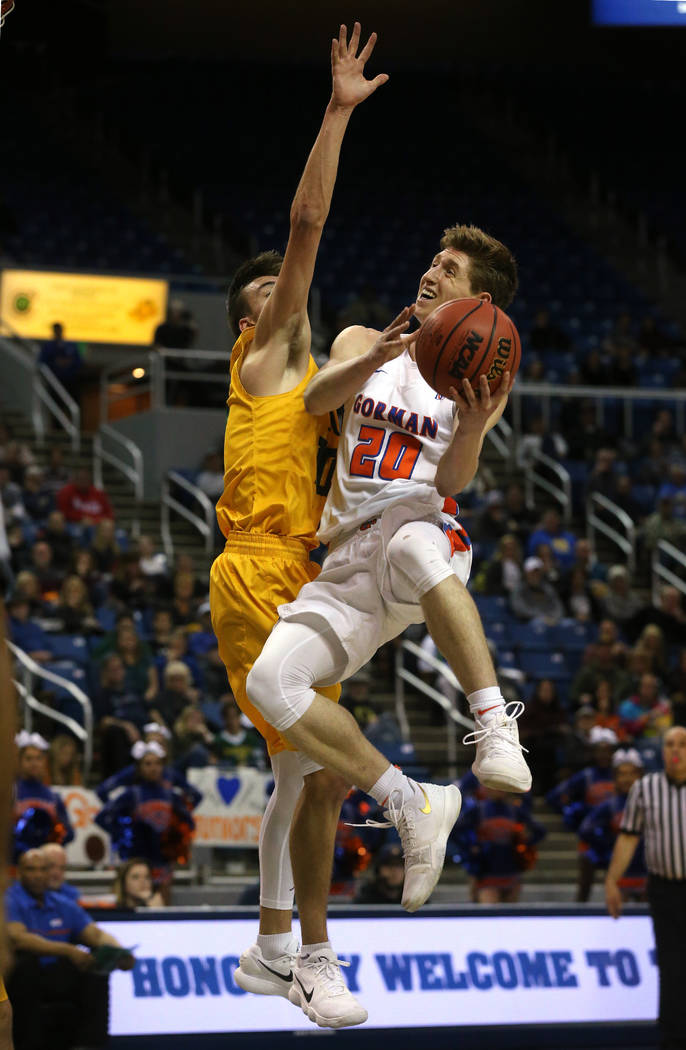 Bishop Gorman's Noah Taitz shoots over a Bishop Manogue defender in the 4A NIAA state basketball championship game in Reno, Nev., on Friday, Feb. 23, 2018. Gorman won 62-41. Cathleen Allison/Las V ...