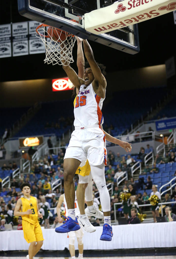 Bishop Gorman's Jamal Bey dunks against a Bishop Manogue defender during the 4A NIAA state basketball championship game in Reno, Nev., on Friday, Feb. 23, 2018. Gorman won 62-41. Cathleen Allison/ ...