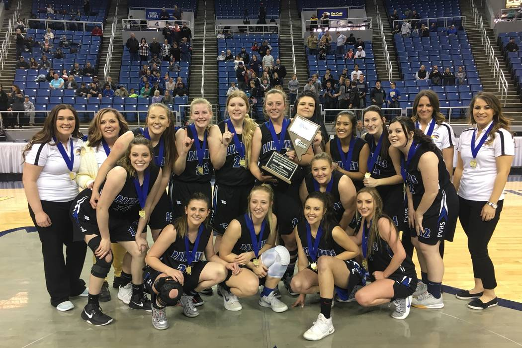 Pahranagat Valley players celebrate their 58-43 win over Wells for the Class 1A girls state basketball title on Saturday, Feb. 24, 2018 at Lawlor Events Center in Reno. (Justin Emerson/Las Vegas R ...