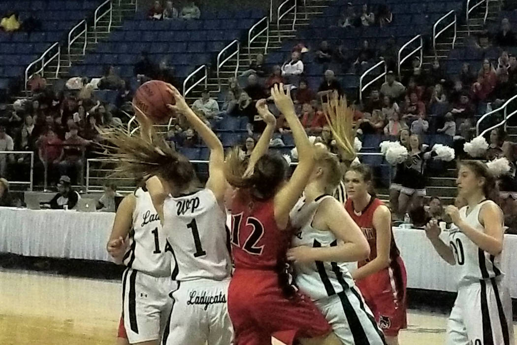 White Pine's Lily Fulmer battles for a rebound with Lincoln County's Kylee Cameron (12) during the Class 2A girls state championship game at Lawlor Events Center in Reno on Saturday, Feb. 24, 2018 ...