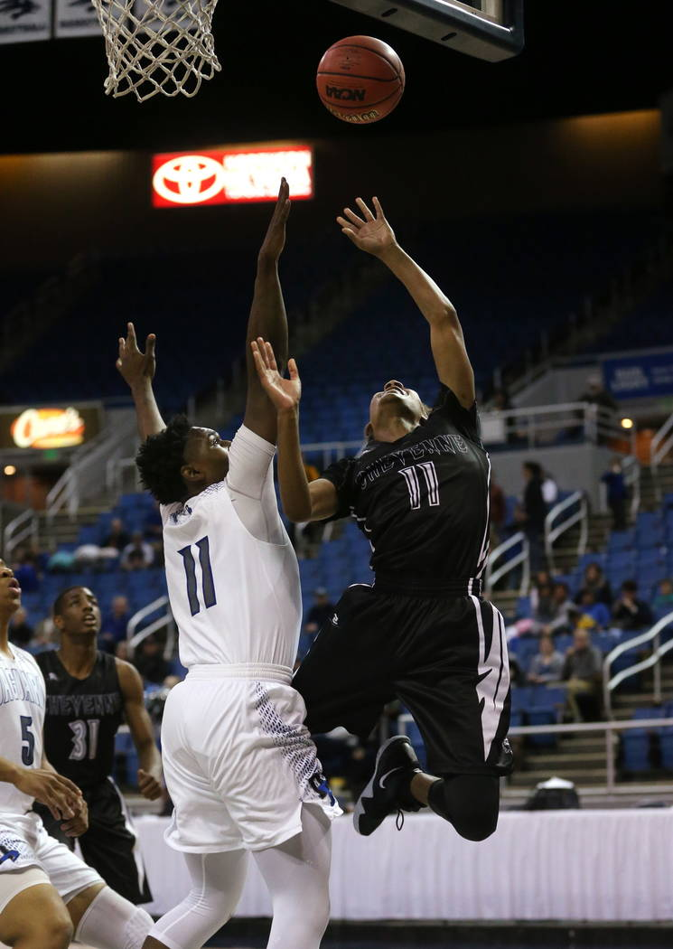 Cheyenne's Ke'shawn Hall shoots past Desert Pines defender Darius Mitchell during the NIAA 3A state basketball championship game in Reno, Nev., on Saturday, Feb. 24, 2018. Desert Pines won 48-44 i ...