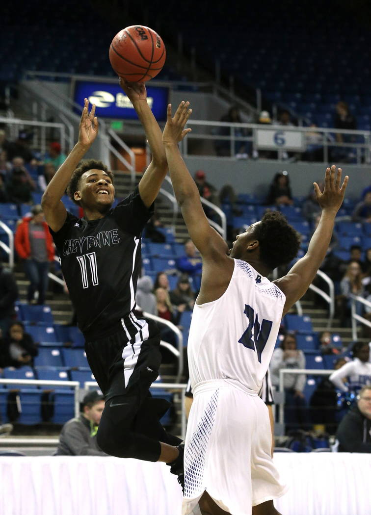 Cheyenne's Ke'shawn Hall shoots over Desert Pines defender Malacki McLaurin during the NIAA 3A state basketball championship game in Reno, Nev., on Saturday, Feb. 24, 2018. Desert Pines won 48-44  ...
