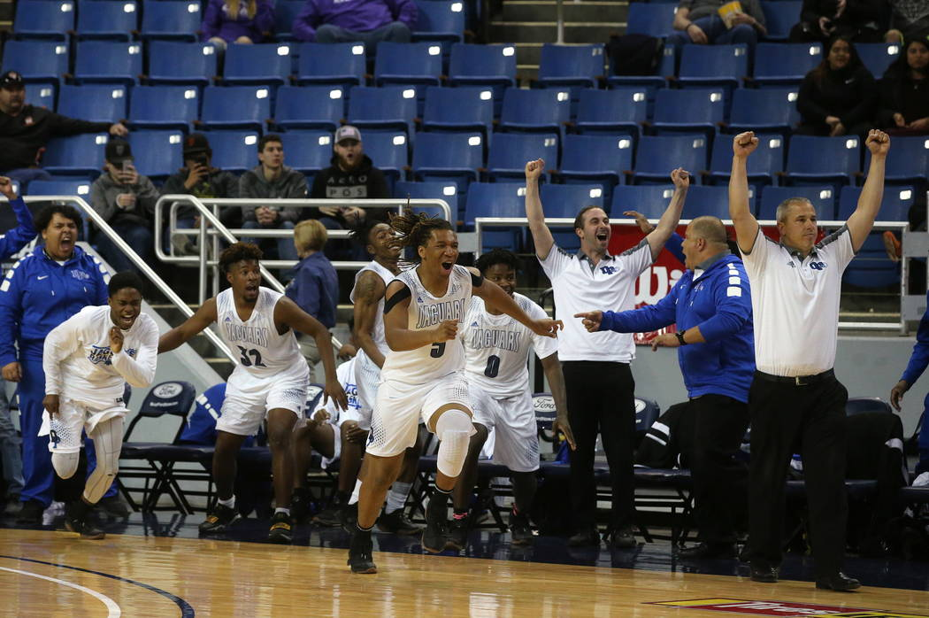 The Desert Pines team celebrates after defeating Cheyenne 48-44 in overtime for the NIAA 3A state basketball championship in Reno, Nev., on Saturday, Feb. 24, 2018. Desert Pines won 48-44 in overt ...