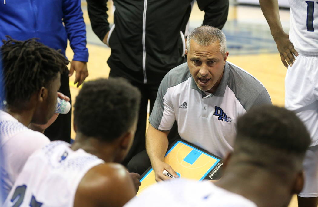 Desert Pines head coach talks to the team during a time out in the NIAA 3A state basketball championship game against Cheyenne in Reno, Nev., on Saturday, Feb. 24, 2018. Desert Pines won 48-44 in  ...