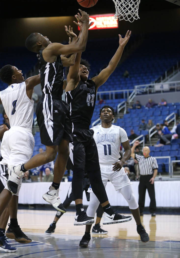 Desert Pines' Dayshawn Wiley, left, and Darius Mitchell and Cheyenne's Kavon Williams and Michael Reed rebound in the NIAA 3A state basketball championship game in Reno, Nev., on Saturday, Feb. 24 ...