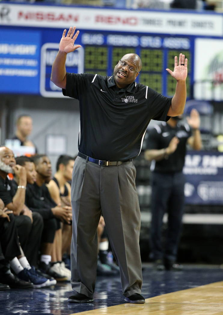 Desert Pines head coach Teral Fair talks to an official in the NIAA 3A state basketball championship game against Cheyenne in Reno, Nev., on Saturday, Feb. 24, 2018. Desert Pines won 48-44 in over ...