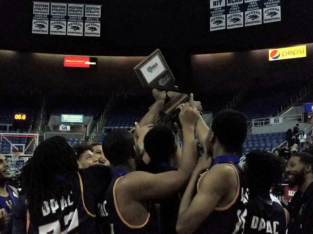 Democracy Prep players celebrate after beating Battle Mountain 72-48 for the Class 2A boys state title at Lawlor Events Center in Reno on Saturday, Feb. 24, 2018. (Damon Seiters/Las Vegas Review-J ...