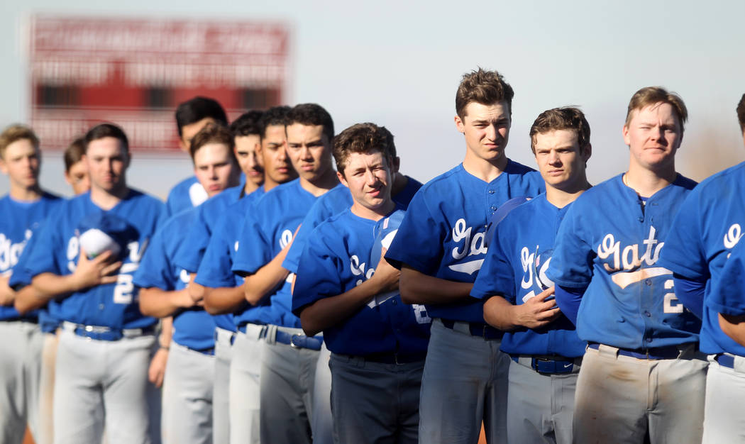Members of the Green Valley baseball team stand for the National Anthem prior to the start of their game against Desert Oasis at Desert Oasis High School in Las Vegas Thursday, March 8, 2018. K.M. ...