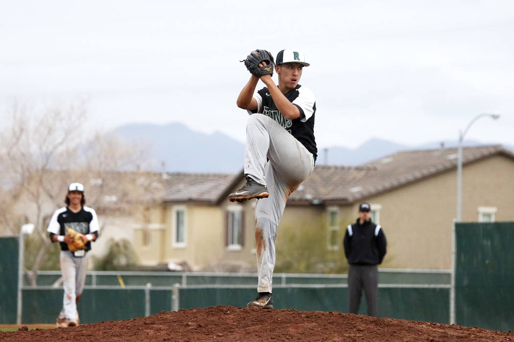 Rancho Rams' Anthony Guzman (27) pitches against the Arbor View Aggies at Desert Oasis High School in Las Vegas on Saturday, March 10, 2018. Andrea Cornejo Las Vegas Review-Journal @DreaCornejo