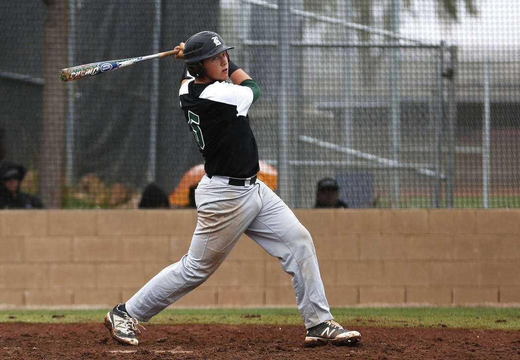Rancho Rams' Matthew Baughn (5) swings during a game against the Arbor View Aggies at Desert Oasis High School in Las Vegas on Saturday, March 10, 2018. Andrea Cornejo Las Vegas Review-Journal @Dr ...