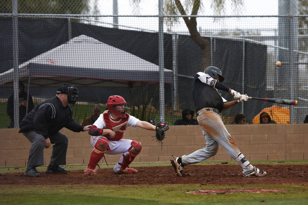 Rancho Rams' Jimmy Gamboa (99) swings during a game against the Arbor View Aggies at Desert Oasis High School in Las Vegas on Saturday, March 10, 2018. Andrea Cornejo Las Vegas Review-Journal @Dre ...