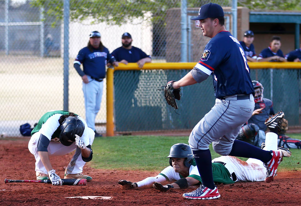 Rancho Rams' Kagen Kennedy (6) slides into home plate during a game against the Liberty Patriots at Rancho High School on Monday, March 12, 2018, in Las Vegas. The Rams won 11-1. Andrea Cornejo La ...