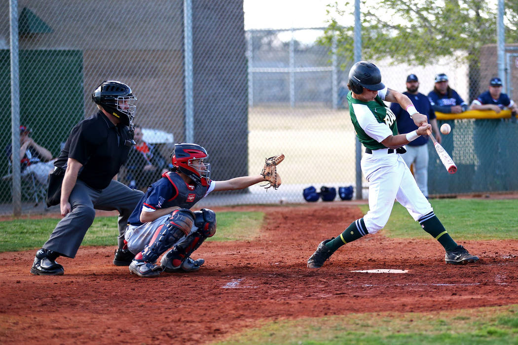 Rancho Rams' Joseph Walls (14) bats against the Liberty Patriots during a baseball game at Rancho High School on Monday, March 12, 2018, in Las Vegas. The Rams won 11-1. Andrea Cornejo Las Vegas R ...