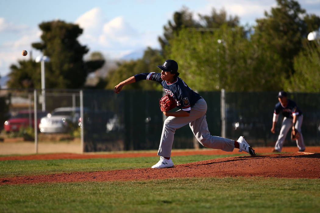 Liberty Patriots' Devin Contreras (13) pitches against the Rancho Rams at Rancho High School on Monday, March 12, 2018, in Las Vegas. The Rams won 11-1. Andrea Cornejo Las Vegas Review-Journal @Dr ...