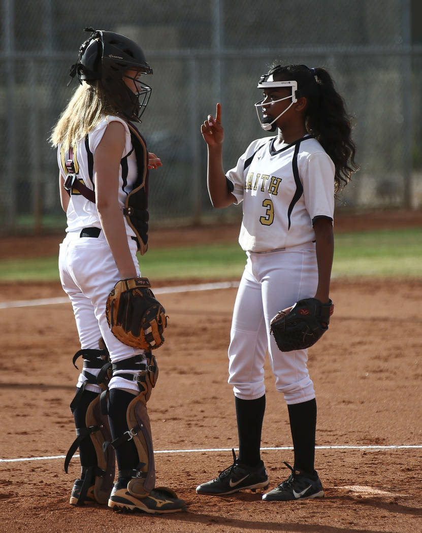 Faith Lutheran pitcher Skye Landaz (3) talks with Faith Lutheran catcher Ellie Fried (12) as they play Centennial during a softball game at Faith Lutheran in Las Vegas on Tuesday, March 13, 2018.  ...