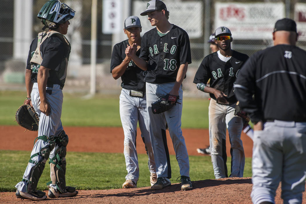 Palo Verde players have a conference on the mound while playing against Cimarron-Memorial at Cimarron-Memorial High School on Wednesday, March 14, 2018. Palo Verde won 12-8.  Patrick Connolly Las  ...