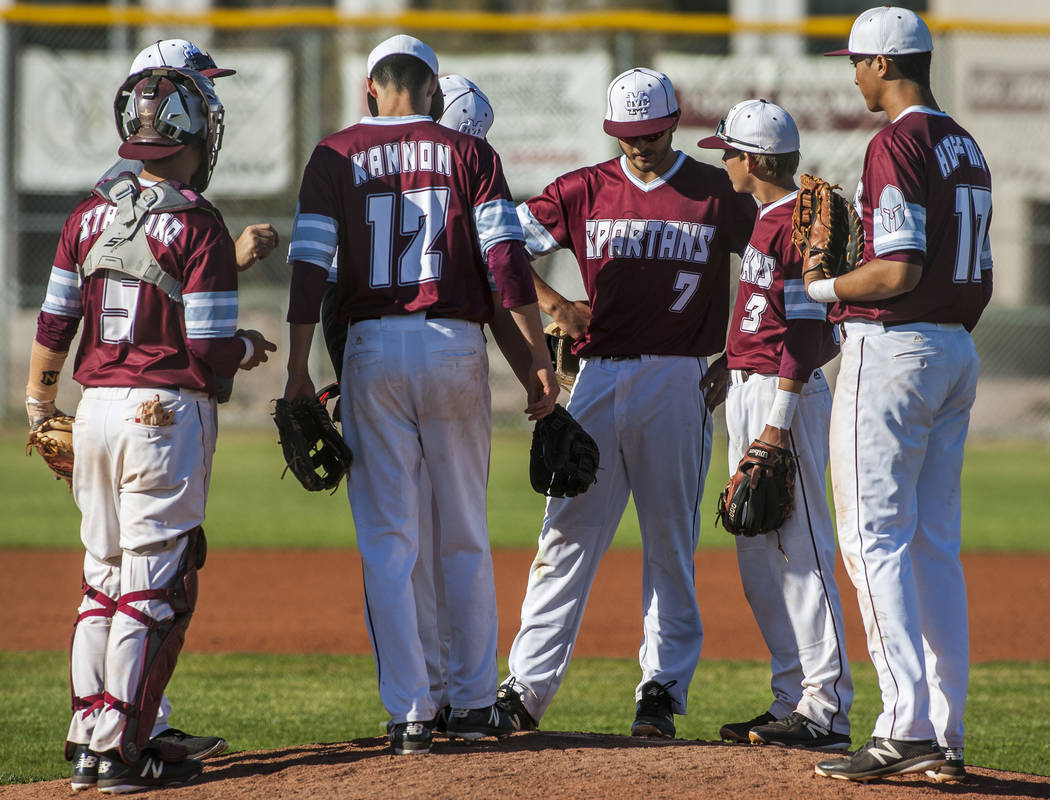 Cimarron-Memorial players come together to talk on the mound while playing against Palo Verde at Cimarron-Memorial High School on Wednesday, March 14, 2018. Palo Verde won 12-8.  Patrick Connolly  ...