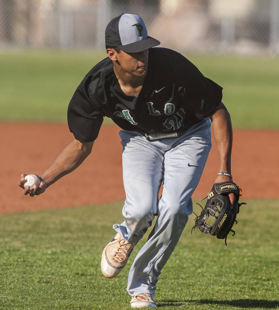 Palo Verde's Jaret Godman scoops up a ball and looks to make a play against Cimarron-Memorial at Cimarron-Memorial High School on Wednesday, March 14, 2018. Palo Verde won 12-8.  Patrick Connolly  ...