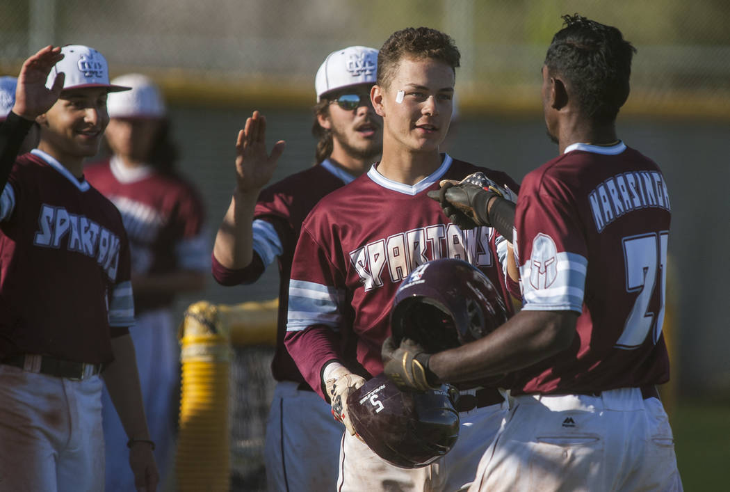 Cimarron-Memorial players celebrate after scoring against Palo Verde at Cimarron-Memorial High School on Wednesday, March 14, 2018. Palo Verde won 12-8.  Patrick Connolly Las Vegas Review-Journal  ...