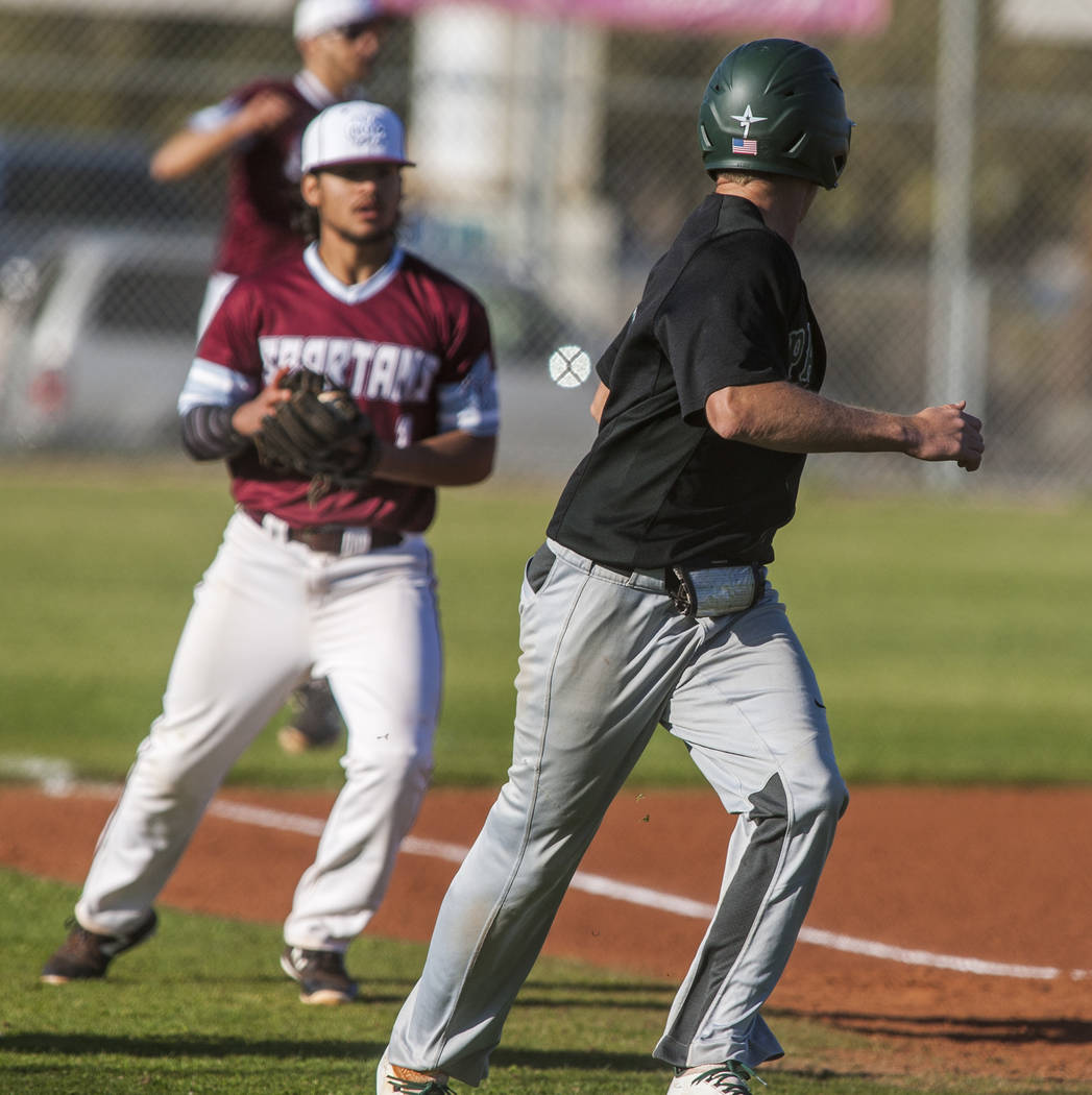 Palo Verde's John Condron gets stuck in between third base and home at Cimarron-Memorial High School on Wednesday, March 14, 2018. Palo Verde won 12-8.  Patrick Connolly Las Vegas Review-Journal @ ...